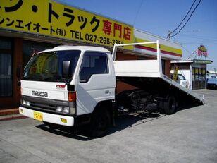 puksiirauto MAZDA Titan